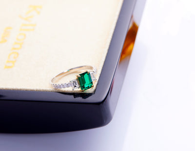 3 Stone Emerald cut Emerald Ring