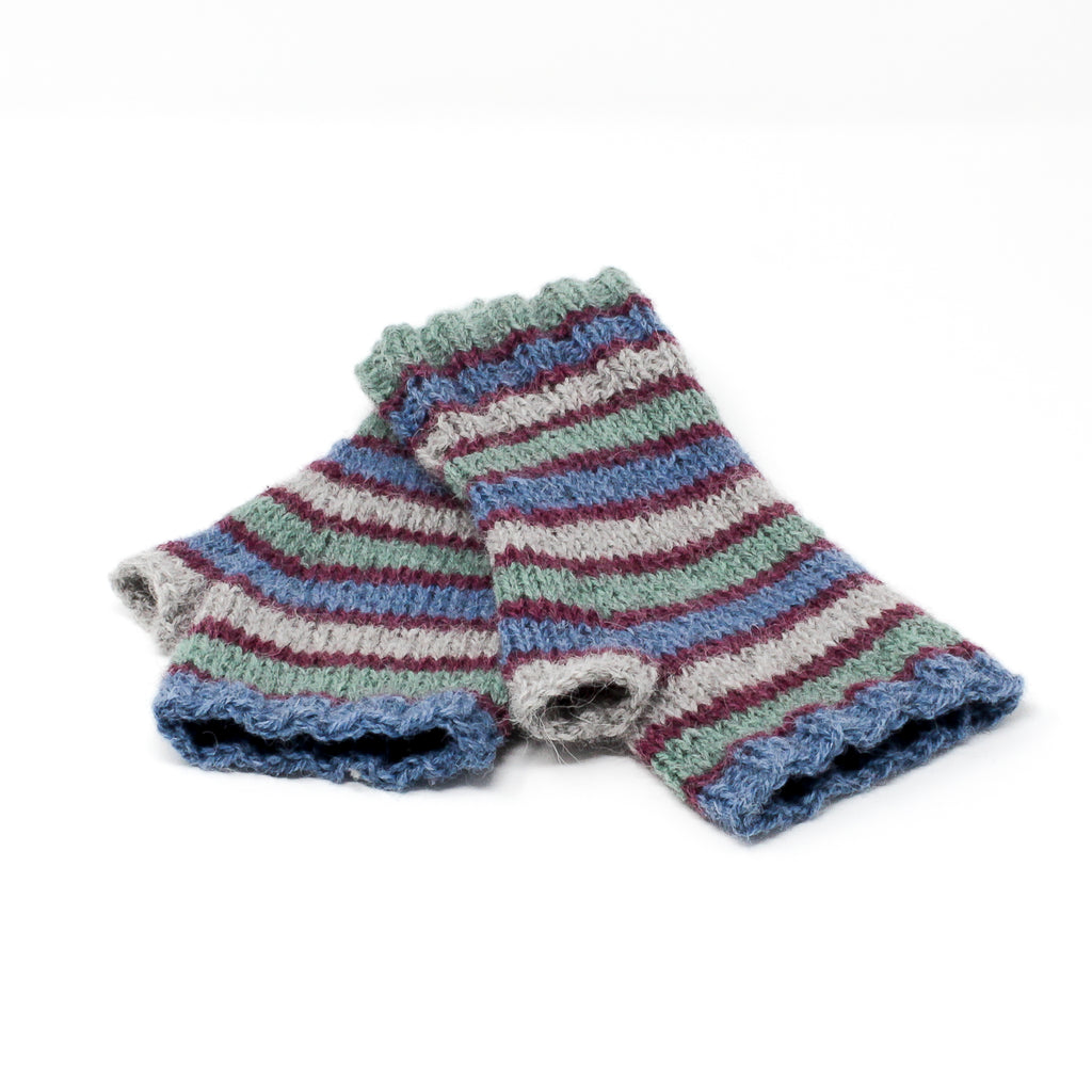 A pair of hand-knitted fingerless gloves using our collection of commercial wool