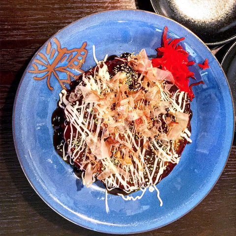 okonomiyaki on blue plate