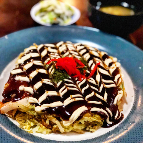large okonomiyaki on a blue plate