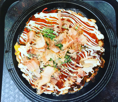 okonomiyaki on black plate