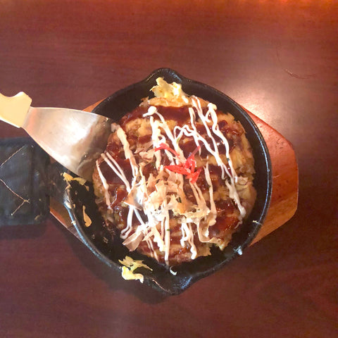 small okonomiyaki with spatula
