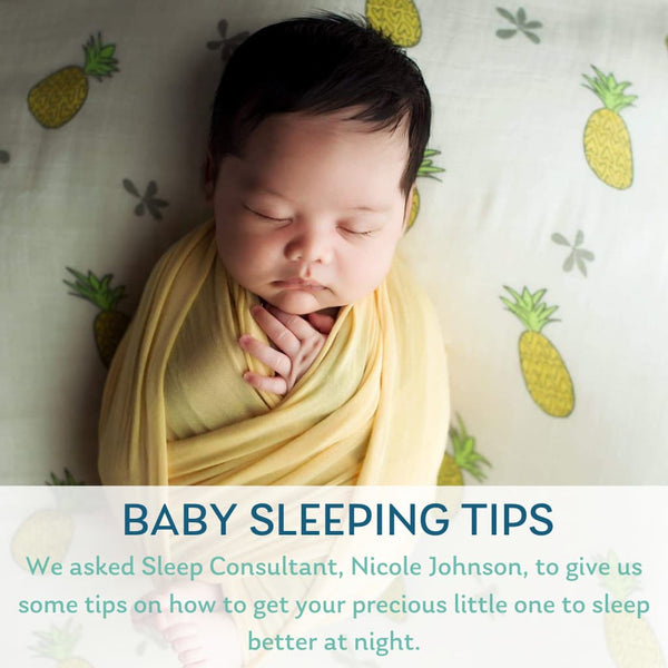 baby on pineapple blanket
