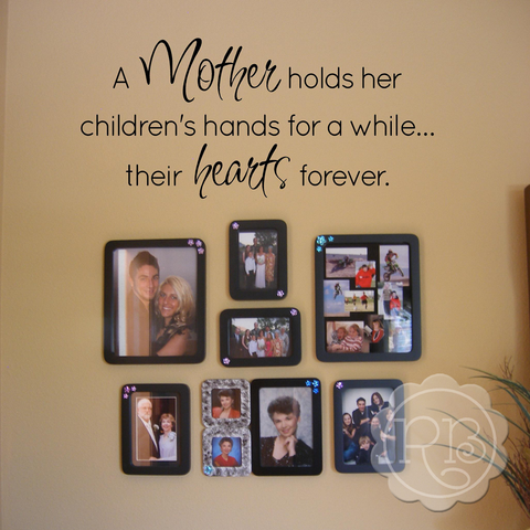 A MOTHER HOLDS Vinyl Wall Quote