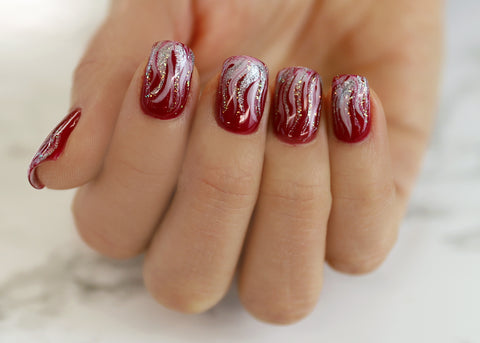 Red festive marble nails manicure