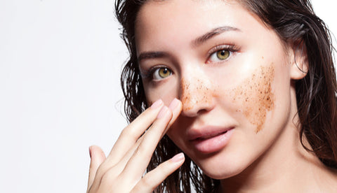 brunette-woman-with-exfoliating-face-mask-on-cheeks-and-nose-exfoliating-body-wash