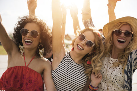three-girlfriends-enjoying-live-music-at-outdoor-festival-all-natural-deodorant