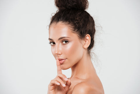woman glowing from natural body cream