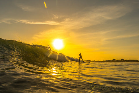 surfing sunset ocean