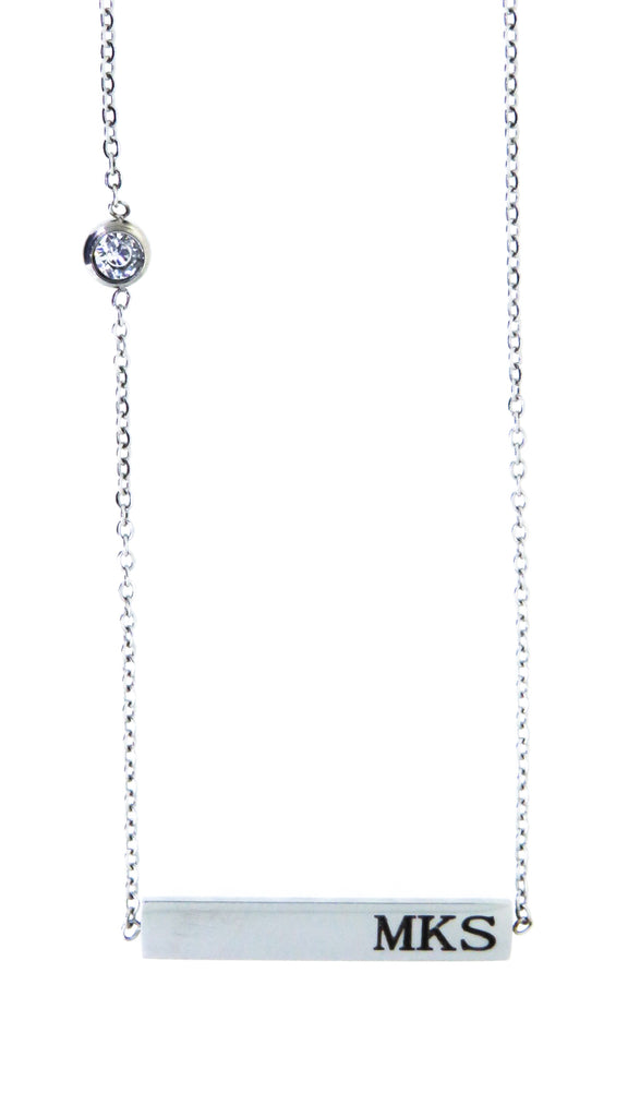 Horizontal bar featuring a Swarovski crystal