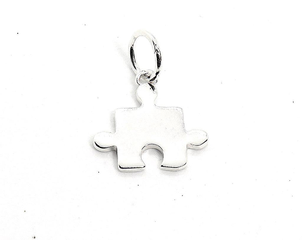 Puzzle Piece Charm in Sterling Silver