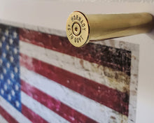 Load image into Gallery viewer, 45-70 Government Brass magnets - Close Up with American Flag