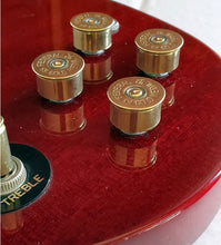 Load image into Gallery viewer, Set of 4 12 gauge guitar knobs on red SG Guitar