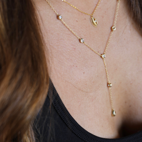 Gold Lariat y necklace