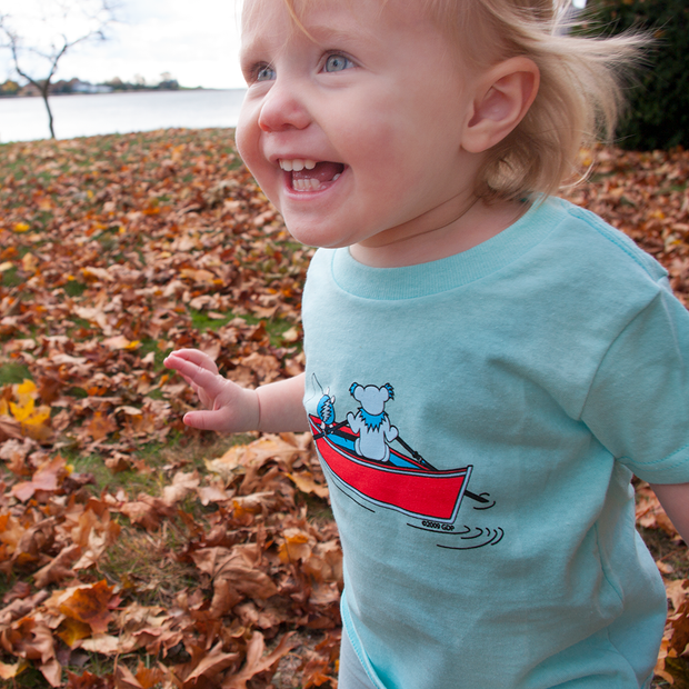 9f7cbdfd6 Young toddler running in fall leaves, wearing a light blue Terrapin and  Bear Dinghy toddler