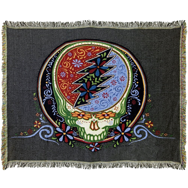 Woven cotton blanket with a Grateful Dead Steal Your Face skull that has a colorful Day of the Dead inspired calaveras design, on a black background