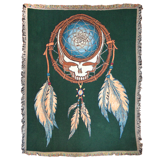 Grateful Dead Steal Your Face skull in a dream catcher with white and blue feathers hanging from it, on a green woven cotton blanket