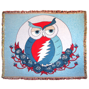 100% cotton throw blanket that has a red, white and blue owl with a Grateful Dead lightning bolt across it's stomach, nesting on roses with a solid blue background