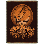 A woven cotton blanket with a wood grain Grateful Dead Stealie, with roots coming out of it's mouth, and the letters GD written in the roots, on a black background