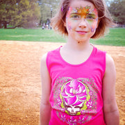 A girl with a painted face standing in a baseball field, wearing a pink Sugar Magnolia Stealie girl's tank top.