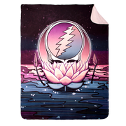 Grateful Dead Stealie nestled in a pink lotus flower, floating on water under a black night sky on a sherpa fleece blanket with the top corner turned down to show the white back side.