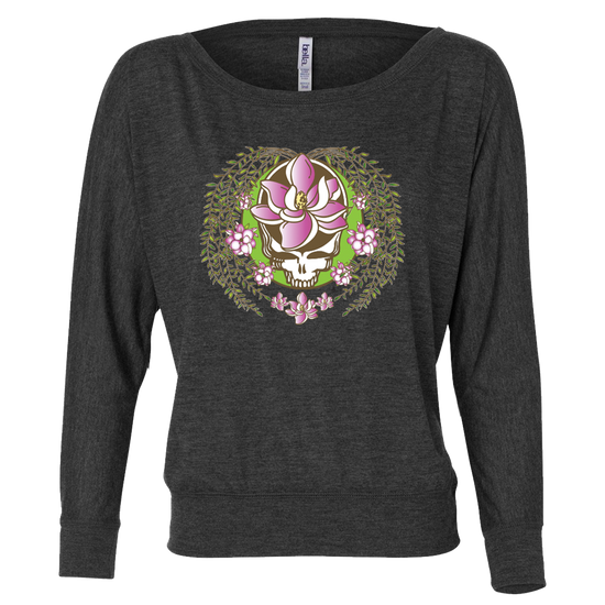A white and green Stealie with a pink sugar magnolia flower in the center and sugar magnolia branches and flowers flowing down the sides to three central flowers at the bottom, on a dark grey women's off-shoulder long sleeve shirt.