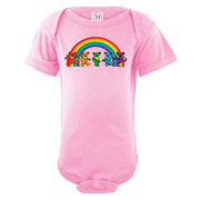 A pink infant one piece, with five Grateful Dead bears dancing in front of a rainbow across the chest.