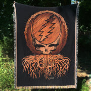 The Grateful Dead Roots Stealie blanket being held up for display outside