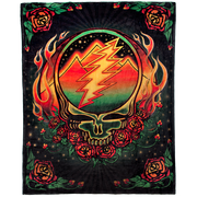 Fleece blanket with a Grateful Dead steal your face resting on a bed of roses, with pyramids and a night sky in the background of the skull, and flames coming up the sides. There are roses in all four corners, with a black background.