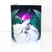 A vertical greeting card of a skeleton with a crown of purple roses skiing down a snowy path in the woods, under a starry night sky with a Grateful Dead helicopter behind her and a Grateful Dead lightning bolt across the sky.
