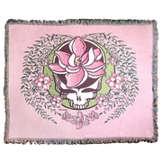 A white and green Stealie with a pink sugar magnolia flower in the center and sugar magnolia branches and flowers flowing down the sides to three central flowers at the bottom, on a pink woven blanket.