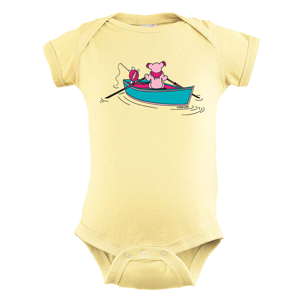 A Grateful Dead bear rowing a dinghy, while a Terrapin turtle fishes off the back, on a yellow infant one piece.