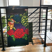 The Terrapin Lake sherpa fleece blanket folded and hanging over a banister