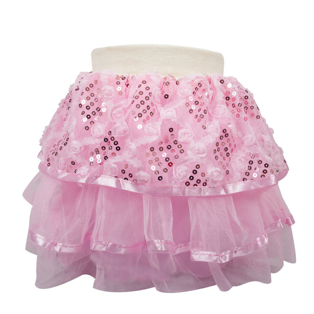 Girls skirt with tiered layers of pink tulle, the outer layer has soft textured roses in a diamond pattern throughout and sequins filling in the diamonds. Soft stretchy cotton waistband.