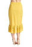 Back view of model wearing yellow cotton eyelet ruffle hem skirt.