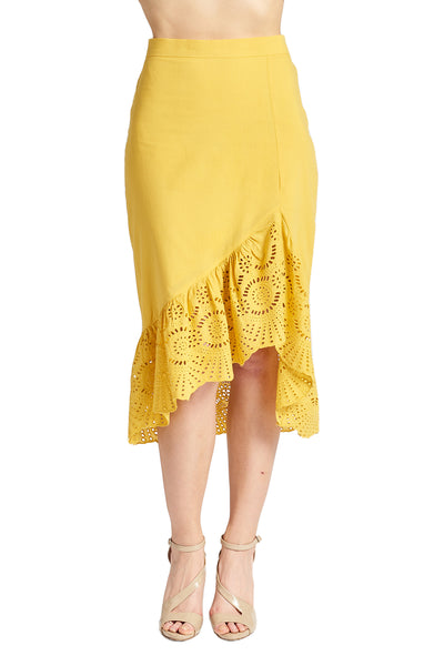 Model wearing yellow cotton eyelet asymmetric ruffle hem skirt.
