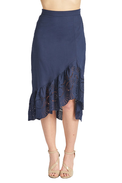 Model wearing navy cotton eyelet asymmetric ruffle hem skirt.