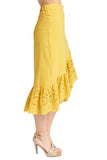 Side view of model wearing yellow cotton eyelet asymmetric ruffle hem skirt.