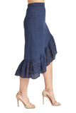 Side view of model wearing navy cotton eyelet asymmetric ruffle hem skirt.
