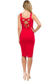 Back view of model wearing body con red stretch midi Ponte dress, with criss cross bands in back top.