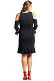 Back view of model wearing above the knee black knit Ponte cold shoulder three quarter sleeve dress with bowties at sleeves, and ruffles at hems.
