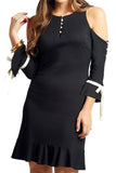 Model wearing above the knee black knit Ponte cold shoulder three quarter sleeve dress with contrast bowties and buttons at sleeves, and ruffles at hems.