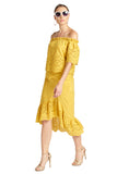 Model wearing yellow cotton eyelet off the shoulder top and yellow asymmetric eyelet ruffle hem skirt.