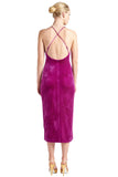 Back view of model wearing magenta stretch velvet midi dress with low back & criss cross adjustable spaghetti straps.