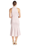 Back view of model wearing light pink stretch satin sleeveless midi dress with mermaid hem.