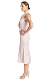 Side view of model wearing light pink stretch satin sleeveless midi dress with pussy bow necktie and mermaid hem.