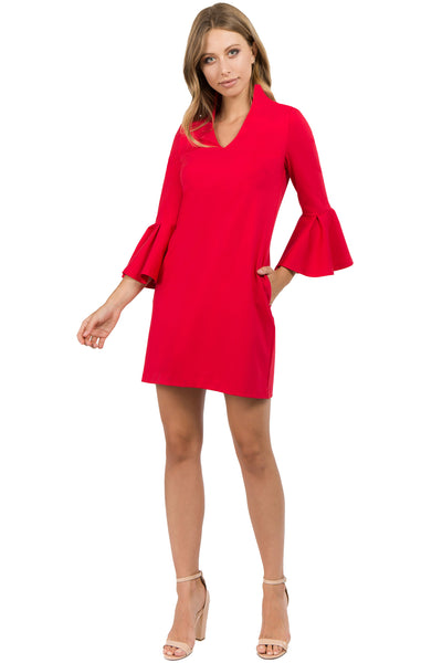 Model wearing red knit Ponte mini shift dress with v-neckline, 3/4 bell sleeves and side slit pockets.
