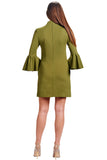 Back view of model wearing olive knit Ponte mini shift dress with v-neckline, 3/4 bell sleeves and side slit pockets.