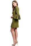 Side view of model wearing olive knit Ponte mini shift dress with v-neckline, 3/4 bell sleeves and side slit pockets.