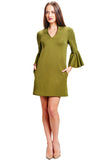 Model wearing olive knit Ponte mini shift dress with v-neckline, 3/4 bell sleeves and side slit pockets.